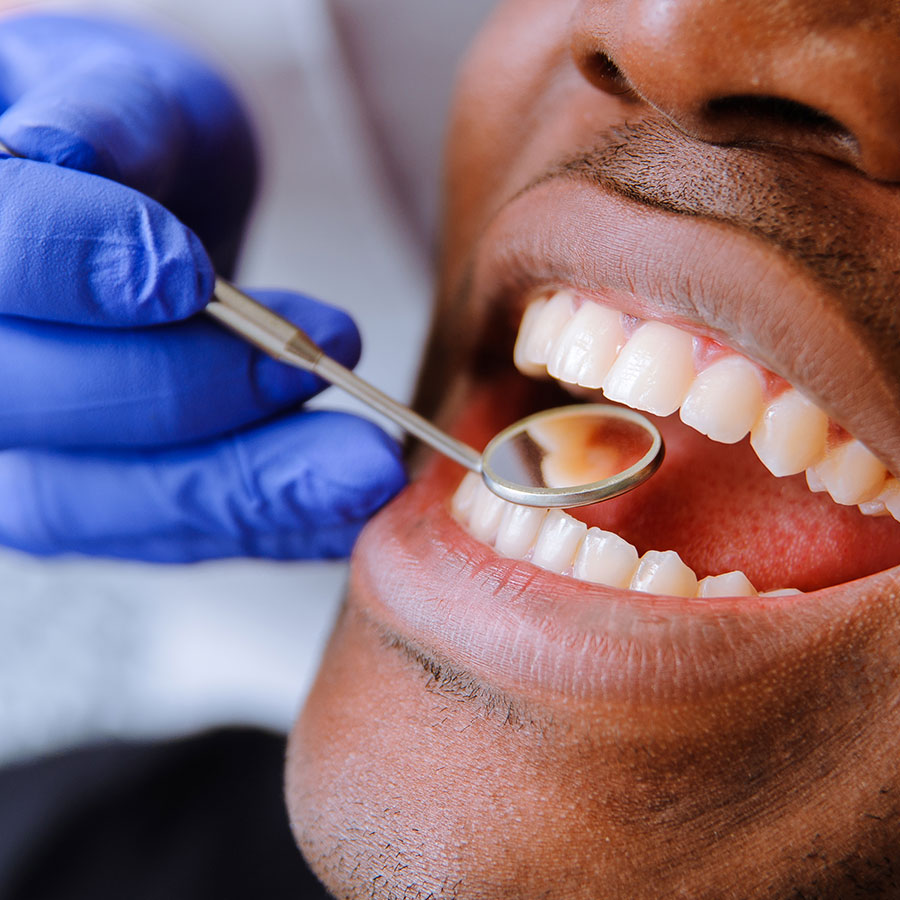 Innovo mobile clinic dentist looking at teet